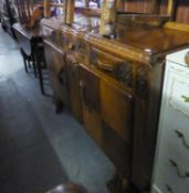 1950's VINE CARVED OAK SIDEBOARD, THREE DRAWERS OVER TWO CUPBOARDS, ON CARVED PANEL FRONT SUPPORTS