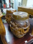 """A PAIR OF MODERN INDONESIAN TEAK DRUM-SHAPE CARVED STANDS/STOOLS, 17 1/2"""" (44.5cm) high (2)"""