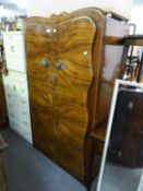 A GENT'S SMALL SEMI-FITTED FIGURED WALNUTWOOD WARDROBE WITH TWO DOORS AND A CHEST OF FIVE DRAWERS