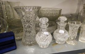 A LARGE COLLECTION OF CUT AND MOULDED GLASSWARES TO INCLUDE; BOWLS, VASES, DECANTERS ETC.....