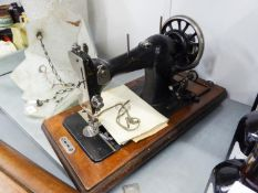 A PORTABLE VICTORIAN SEWING MACHINE IN WOODEN CASE