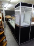 A MATCHING PAIR OF JEWELLERY COUNTER DISPLAY CABINETS, THE LOWER SECTION HAVING STORAGE AREA, THE