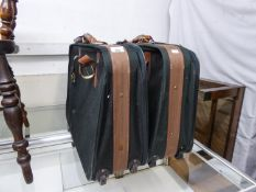 TWO ANTLER GREEN CANVAS SUITCASES