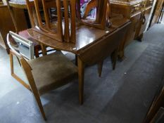 A CIRCULAR FALL-LEAF DIING TABLE WITH FORMICA WOOD EFFECT TOP AND TWO MATCHING CHAIRS (3)