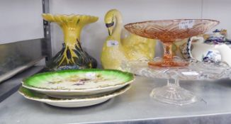 A PAIR OF POTTERY WALL PLATES, POTTERY SWAN PATTERN TABLE CENTRE ON PEDESTAL STAND AND TWO GLASS