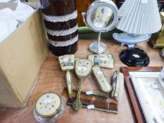 A LADY'S GILT METAL AND PICTORIAL BACKED DRESSING TABLE BRUSH SET OF 4 PIECES, ANOTHER SIMILAR SET