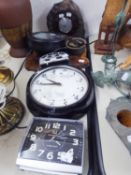 A CIRCULAR WALL CLOCK IN BLACK CASE, A CIRCULAR BAROMETER IN STONE CASING, OTHER MANTEL AND ALARM
