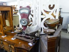 A LARGE SHOP SCALE AND A KITCHEN BALANCE SCALE WITH PANS AND WEIGHTS