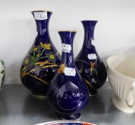 A MODERN JAPANESE PORCELAIN OVULAR VASE AND DOMED COVER WITH FINIAL AND TWO GINGER JARS AND