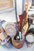 A WOODEN BARREL SHAPED TUB CONTAINING VINTAGE SPORTS EQUIPMENT, VIZ TENNIS RACQUETS, TABLE TENNIS