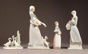 """THREE LLADRO PORCELAIN FIGURES AND A NAO MODEL of three geese, the largest 11"""" (28cm) high (4)"""