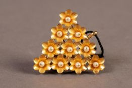 INDIAN TRIANGULAR PENDANT comprising ten flower heads each with a small pearl, 3.7gms, in