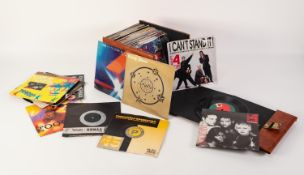 VINYL RECORDS SINGLES. Various 45rpm singles house in a brown carry case. A mixture of genre and