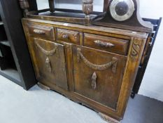 1950's CARVED OAK ENCLOSED SIDEBOARD, WITH THREE DRAWERS OVER A CUPBOARD WITH TWO DOORS