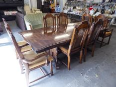 A CONTINENTAL WALNUT DINING ROOM SUITE OF 9 PIECES, TO INCLUDE; EXTENDING DINING TABLE WITH TWO