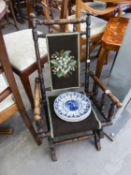 AN EARLY TWENTIETH CENTURY STAINED BEECHWOOD CHILDS ROCKING CHAIR, ALSO FOUR WEDGWOOD POTTERY RACK