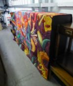 A LARGE PADDED MULTI-COLOURED WALL HANGING (FADED) APPROX 230cm x 190cm