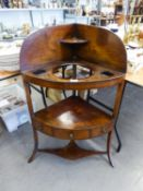 A GEORGE III MAHOGANY CORNER WASH STAND OF THREE TIERS AND THREE SMALL DRAWERS