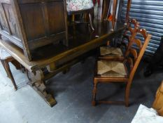 A TWENTIETH CENTURY OAK DRAW-LEAF TRESTLE END DINING TABLE AND SIX DINING CHAIRS
