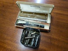 A BOXED SHEAFFER  FOUNTAIN PEN, BOXED PROPELLING PENCIL AND A TIN OF PEN NIBS