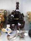 A PAIR OF INDIAN CARVED EBONY ELEPHANT BOOKENDS; AN EBONY ELEPHANT TABLE LAMP; A COPPER MODEL OF A
