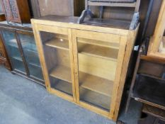 OAK DWARF BOOKCASE, ENCLOSED BY TWO GLAZED DOORS
