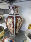 A LARGE ORIENTAL PORCELAIN HEXAGONAL VASE, PAINTED WITH EXOTIC BIRDS, 41cm high
