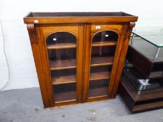 MAHOGANY SUPERSTRUCTURE BOOKCASE, HAVING GLAZED PANEL DOORS