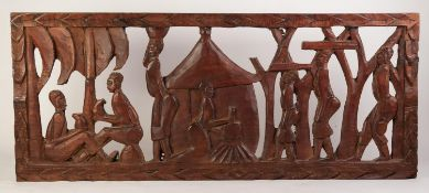 AFRICAN CARVED OPENWORK WALL MOUNTED APPLIQUE OF NATIVE FIGURES AT WORK includes female in hut