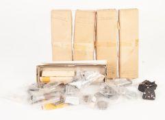FOUR BOXED C.C.W MODELS DIECAST METAL 'O' GAUGE COACH BOGIE KITS, in original straw colouredboxes