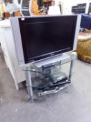 PHILIPS FLAT SCREEN TELEVISION, 26?, WITH THREE-TIER STAND WITH PLATE GLASS SHELVES, ALSO A BT