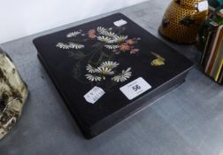 A BLACK LACQUERED PAPIER MACHE SHALLOW BOX AND COVER