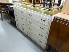 TWO CREAM FOUR DRAWER CHESTS OF DRAWERS