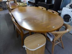 A LARGE EXTENDING POSSIBLY DANISH TEAK EXTENDING DINING TABLE AND FOUR TEAK DINING CHAIRS (5)