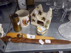 AN AFRICAN CARVED WOOD FIGURAL PAPERKNIFE; EDINBURGH SOUVENIR WOODEN PAPERKNIFE; A SOUVENIR MUG,