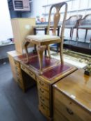 A PALE FIGURED WALNUTWOOD DOUBLE PEDESTAL DESK, WITH NINE DRAWERS WITH RED LEATHER INSETS TO THE