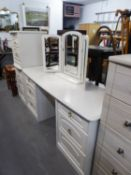A MODERN WHITE FINISH DOUBLE PEDESTAL DRESSING TABLE WITH TRIPLE MIRRORS AND THE MATCHING TWO DRAWER