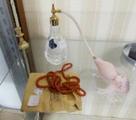 A CONTINUOUS NECKLACE OF UNIFORM CORAL BEADS AND A STUART CRYSTAL PERFUME ATOMISER