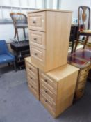 A SET OF THREE BEECH WOOD THREE DRAWER BEDSIDE CHESTS AND A MODERN SEMI-ARMED EASY CHAIR, IN BLUE