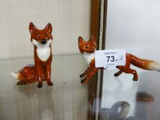 TWO BESWICK CHINA MODELS OF FOXES (2)