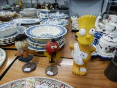A PAIR OF COMIC FIGURES, ZEBEDEE AND FLORENCE AND A PLASTIC BOTTLE IN THE FORM OF HOMER SIMPSON (3)