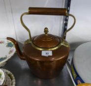 AN ANTIQUE COPPER KETTLE