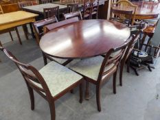 GOOD QUALITY MAHOGANY OVAL DINING TABLE ON FOUR SPUR BASE AND A SET OF SIX DINING CHAIRS ON TAPERING