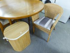 A CANE TUB ARMCHAIR AND A SLATTED WOOD OVAL LINEN RECIEVER