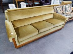A LOUNGE SUITE OF THREE PIECES WITH OAK FRAME AND SHOW WOOD FRONTS, COVERED IN GOLD VELVET, VIZ A
