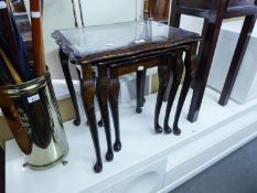 A NEST OF THREE MAHOGANY COFFEE TABLES WITH PLATE GLASS PROTECTORS AND A MAHOGANY TELEVISION STAND