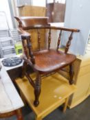 A HARDWOOD ?CAPTAINS? CHAIR WITH PANEL SEAT, ON TURNED LEGS WITH ?H? STRETCHER RAILS