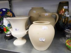A PAIR OF WEDGWOOD WHITE POTTERY URN SHAPED VASES AND THREE ITEMS OF LOVATTS WHITE POTTERY, VIZ