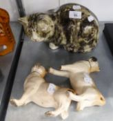 A POTTERY MODEL OF A CAT AND A PAIR OF STAFFORDSHIRE DOGS STANDING (ONE LEG BROKEN)