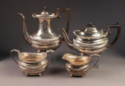 EDWARD VII FOUR PIECE SILVER TEA AND COFFEE SET BY NATHAN & HUGHES, of rounded oblong form with